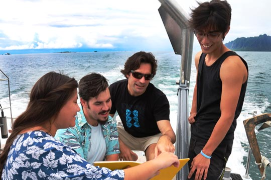 students doing research on a boat in hawaii
